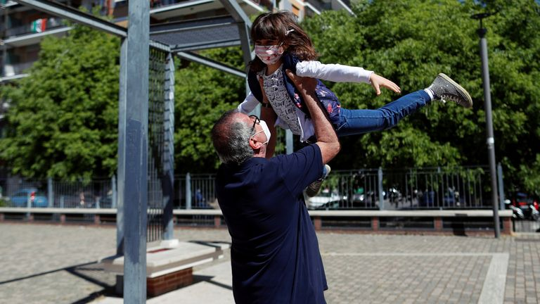 Domenico di Massa plays with his granddaughter Cecilia for the first time in two months after Italy allowed families to see each other again as the country begins a staged end to a nationwide lockdown due to a spread of the coronavirus disease
