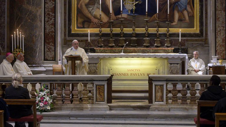 Pope Francis leads a private Mass in a side chapel of St. Peter's Basilica