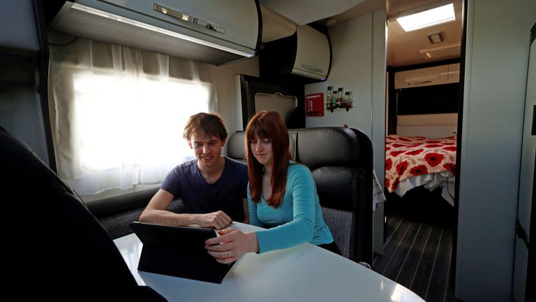 Junior Doctors Jared Leggett and Amy Kitchen watch a film on an iPad, whilst living in a temporary motorhome in the hospital carpark at The Royal Blackburn Teaching Hospital in East Lancashire following the outbreak of the coronavirus disease. PA Photo. Picture date: Thursday May 14, 2020. The married couple, who were living with parents and in the process of buying their first home, made the decision to isolate in the onsite accommodation to protect their families and be able to continue working at hospital. See PA story HEALTH Coronavirus. Photo credit should read: Hannah McKay/PA Wire