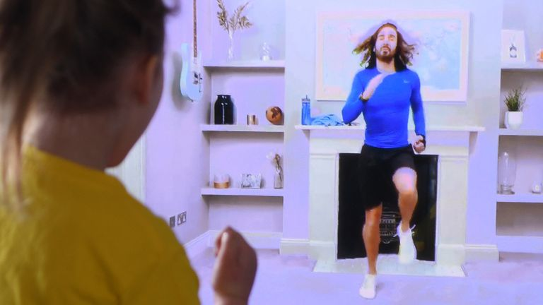 Four-year-old Lois Copley-Jones takes part in a live streamed broadcast of PE with fitness trainer Joe Wicks