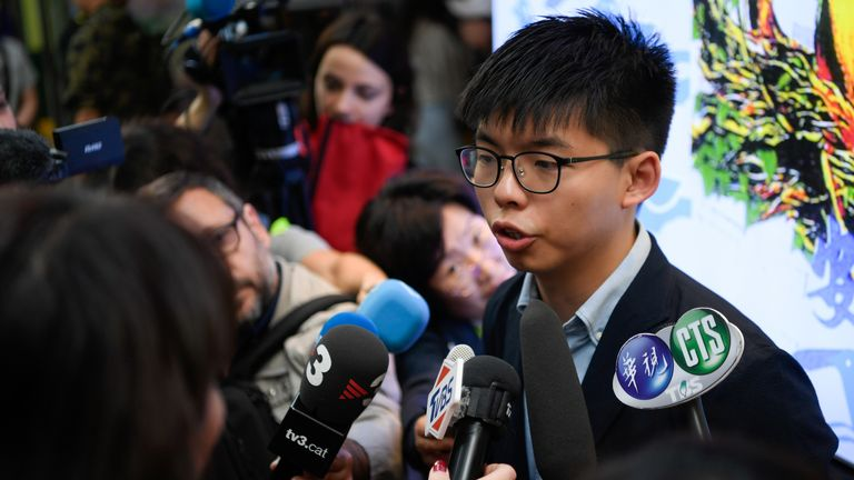 Democracy activist Joshua Wong (pictured in November) defended today's protests
