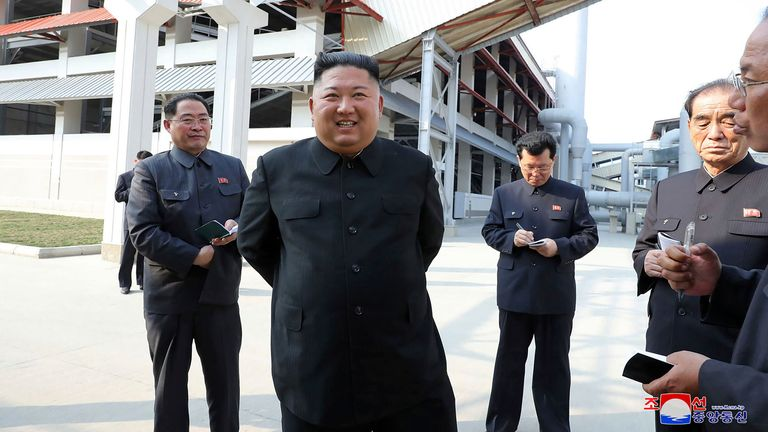 North Korean leader Kim Jong Un, center, visits a fertilizer factory in South Pyongan, near Pyongyang, North Korea