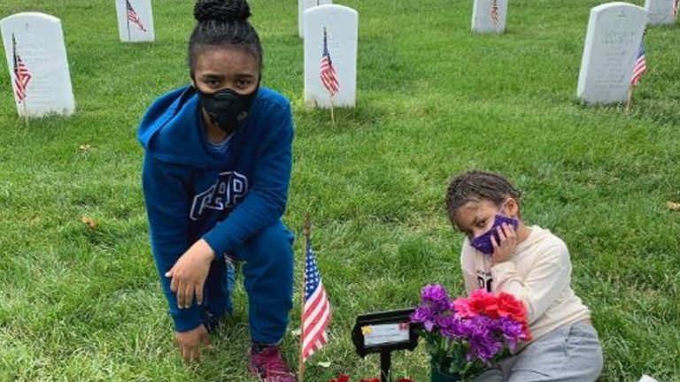 Leilani's younger sisters at her grave in Arlington National Cemetery
