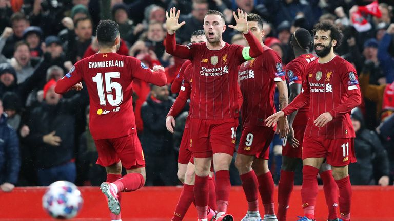 Liverpool players celebrate in their final match before the lockdown brought an end to fixtures
