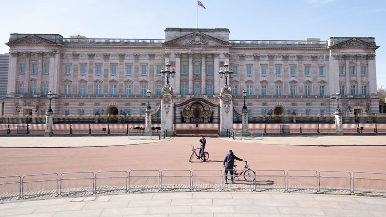 A quiet Buckingham Palace and Queen Victoria Monument on March 24, 2020 in London, England