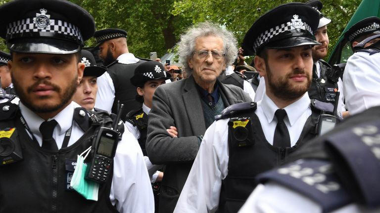 Police lead away Piers Corbyn, brother of former Labour leader Jeremy Corbyn, as protesters gather in breach of lockdown rules in Hyde Park in London after the introduction of measures to bring the country out of lockdown