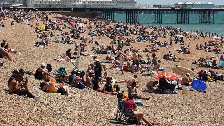 People took the opportunity to sunbathe on Brighton beach on Sunday