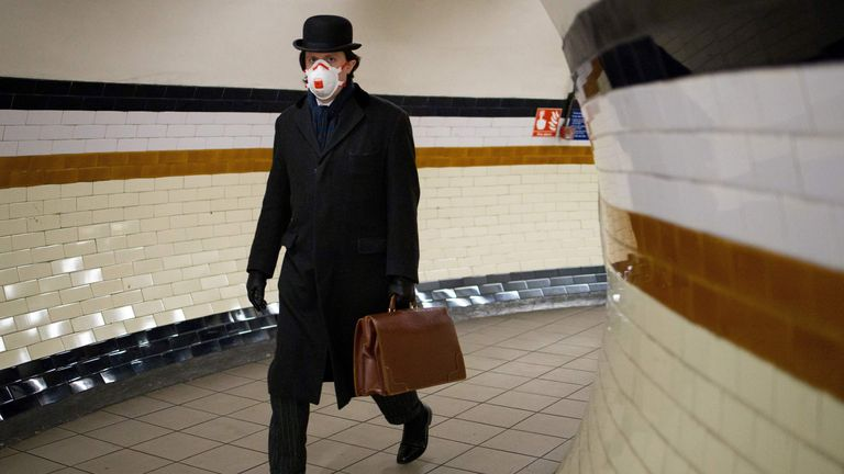 A commuter pictured in a face mask on the London Underground earlier this month