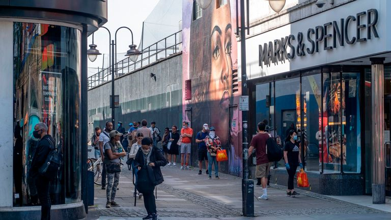 M&S food shoppers queue to enter the store in Brixton, south London, last month