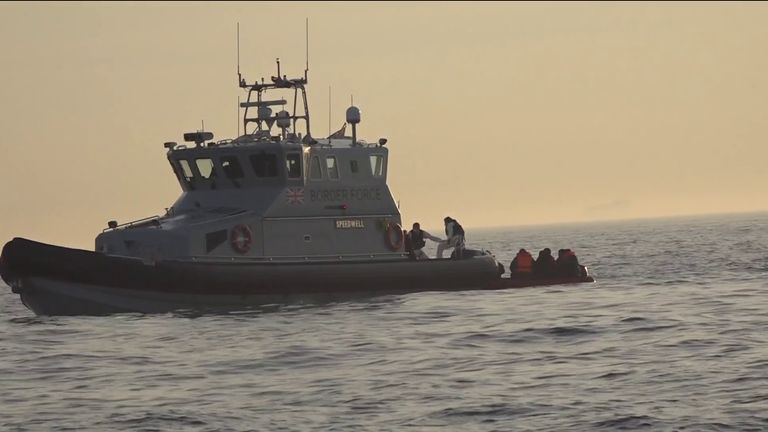 Migrants shadowed by a French naval vessel