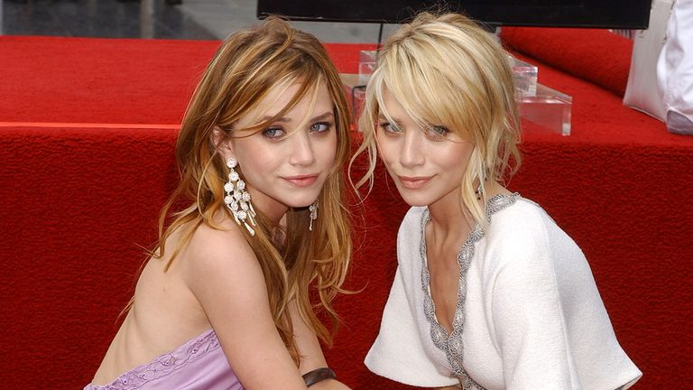 Mary-Kate Olsen and Ashley Olsen during Mary-Kate Olsen and Ashley Olsen Honored with a Star on the Hollywood Walk of Fame for Their Achievements in Television at Hollywood Boulevard in Hollywood, California, United States. (Photo by Gregg DeGuire/WireImage)