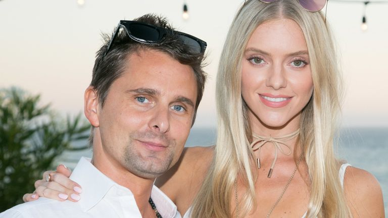 Matt Bellamy of Muse (L) and girlfriend Elle Evans (R) attend the Treats! Magazine 4th Annual White Party Sponsored By Stella Artois on September 17, 2016 in Malibu, California