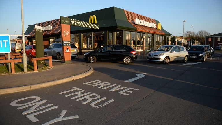 Long queues outside a McDonald's restaurant and drive through before its closure in March