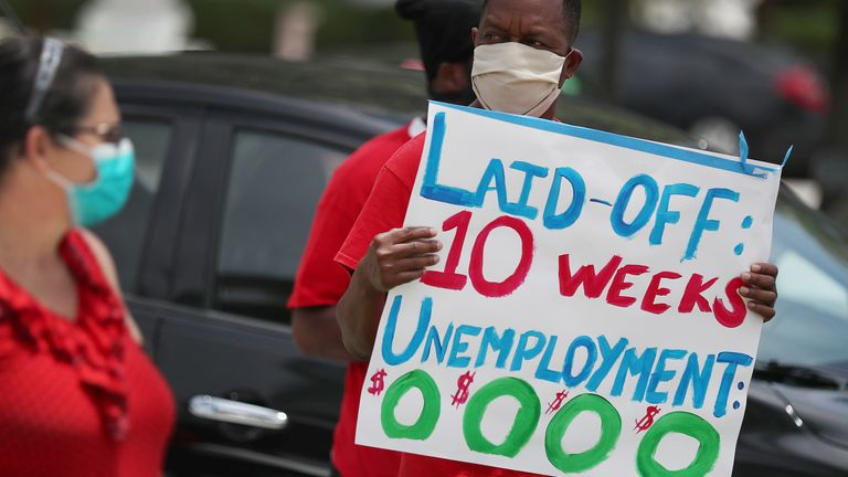 Joseph Louis joins others in a protest asking the state of Florida to fix its unemployment system on May 22, 2020 in Miami Beach, Florida