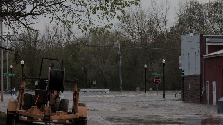 Floodwaters are seen along a street in downtown Sanford, Michigan