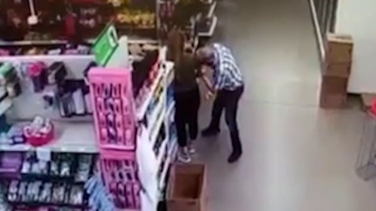 Man 'wipes his nose' on shop worker's clothing