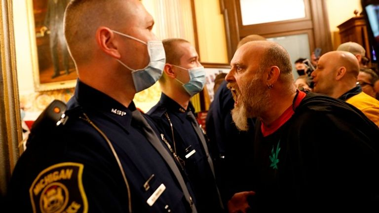 Protesters shouted at police to let them in the chamber