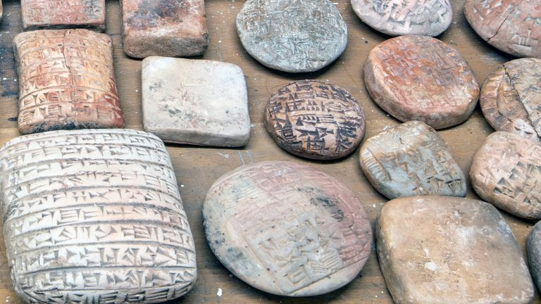 The clay tablets had illegible cuneiform inscriptions on them