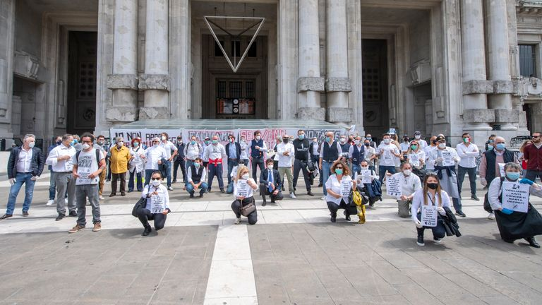 Restaurant owners stage a protest at Milan's main train station