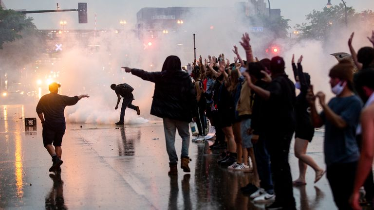 "MINNEAPOLIS, MN - MAY 26: Tear gas is fired as protesters clash with police while demonstrating against the death of George Floyd outside the 3rd Precinct Police Precinct on May 26, 2020 in Minneapolis, Minnesota. Four Minneapolis police officers have been fired after a video taken by a bystander was posted on social media showing Floyd's neck being pinned to the ground by an officer as he repeatedly said, ""I can...t breathe"". Floyd was later pronounced dead while in police custody after being transported to Hennepin County Medical Center. (Photo by Stephen Maturen/Getty Images)"