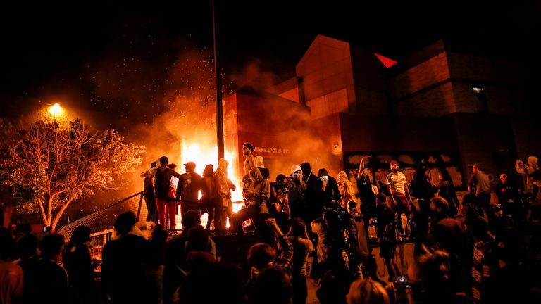 Protesters set fire to a police station in Minneapolis