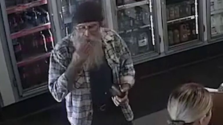 Man seen licking cash on shop CCTV