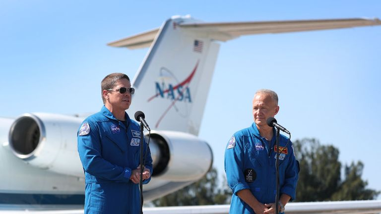 CAPE CANAVERAL, FLORIDA - MAY 20: NASA astronauts Bob Behnken (L) and Doug Hurley speak to the media after arriving at the Kennedy Space Center on May 20, 2020 in Cape Canaveral, Florida. The astronauts arrived for the May 27th scheduled inaugural flight of SpaceX's Crew Dragon spacecraft. They will be the first people since the end of the Space Shuttle program in 2011 to be launched into space from the United States. (Photo by Joe Raedle/Getty Images)