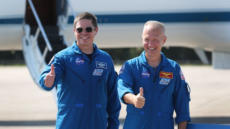 CAPE CANAVERAL, FLORIDA - MAY 20: NASA astronauts Bob Behnken (left) and Doug Hurley (right) pose for the media after arriving at the Kennedy Space Center on May 20, 2020 in Cape Canaveral, Florida. The astronauts arrived for the May 27th scheduled inaugural flight of SpaceX's Crew Dragon spacecraft. They will be the first people since the end of the Space Shuttle program in 2011 to be launched into space from the United States. (Photo by Joe Raedle/Getty Images)