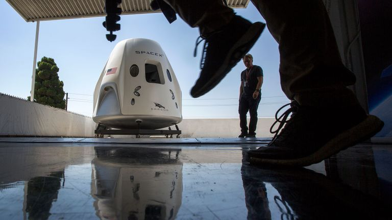 HAWTHORNE, CA - AUGUST 13: A mock up of the Crew Dragon spacecraft is seen during a media tour of SpaceX headquarters and rocket factory on August 13, 2018 in Hawthorne, California. SpaceX plans to use the spaceship Crew Dragon, a passenger version of the robotic Dragon cargo ship, to carry NASA astronauts to the International Space Station for the first time since the Space Shuttle program was retired in 2011. (Photo by David McNew/Getty Images)