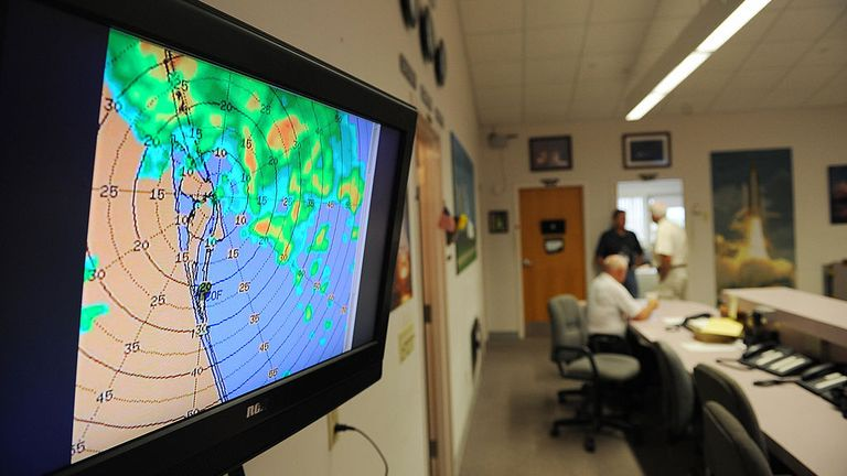 A weather map showing nearby thunder storms May 22, 2009 in the media center at Kennedy Space Center in Florida as NASA waves off the landing of the space shuttle Atlantis due to approaching thunderstorms. NASA will try again May 23. AFP PHOTO/Stan HONDA (Photo credit should read STAN HONDA/AFP via Getty Images)