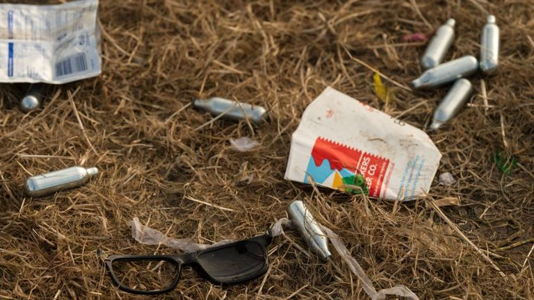 Discarded nitrous oxide canisters are scattered on the ground in front of the Pyramid Stage at the end of the Glastonbury Festival of Music and Performing Arts on Worthy Farm near the village of Pilton in Somerset, South West England, on June 26, 2017. / AFP PHOTO / Oli SCARFF (Photo credit should read OLI SCARFF/AFP via Getty Images)