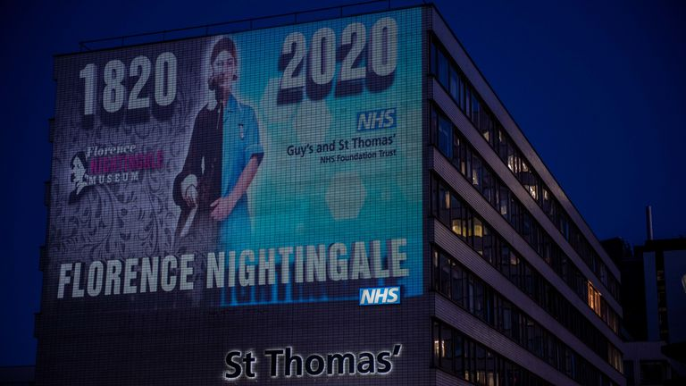 A projection on the side of St. Thomas Hospital marks the 200th anniversary of Florence Nightingale