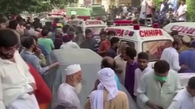 Emergency services and crowds fill the streets in Pakistan as plane crashes