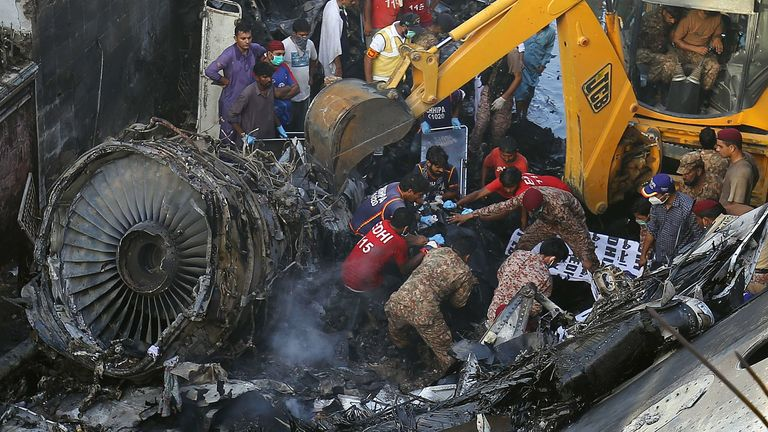 Mandatory Credit: Photo by SHAHZAIB AKBER/EPA-EFE/Shutterstock  Officials try to salvage the wreckage of the passenger plane of state run Pakistan International Airlines, at the crash scene in a residential area, in Karachi, Pakistan, 22 May 2020. A Pakistan International Airlines passenger flight with over 100 people on board crashed on 22 May as it was about to land near a residential area close to the airport in the port city of Karachi, a civil aviation official said. PIA Airbus