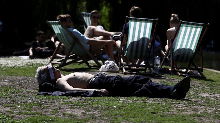 People sunbathe in hot weather in Regent's Park in London