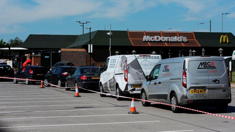 Queues continued at Peterborough McDonalds today, more than 24 hours after the first takeaways re-opened. Pic: Peterborough Telegraph /SWNS
