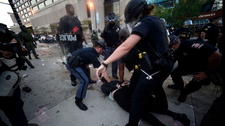 Police officers and protesters clash near CNN center, Friday, May 29, 2020 in Atlanta. The protest started peacefully earlier in the day before demonstrators clashed with police. (AP Photo/Mike Stewart)