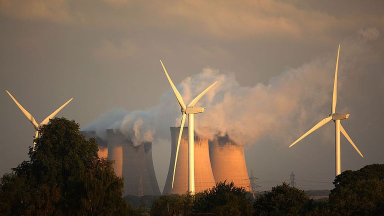 Recently installed wind turbines generate electricty in the shadow of Drax, Europe's biggest coal fired power station, on August 24, 2010 in Selby, England..Thr Rusholme wind farm will create 24 Mega Watts when fully operational in comparison to Drax which creates 3,960 Mega Watts.