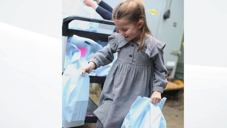 Princess Charlotte was pictured helping to load a van with food for those in need