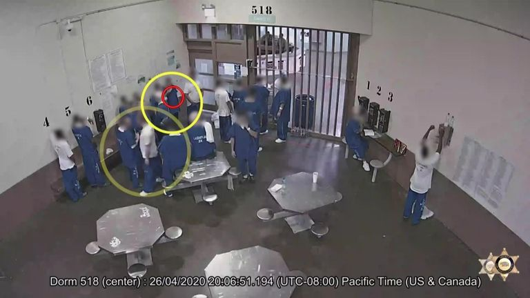 The inmates are seen sharing water bottles