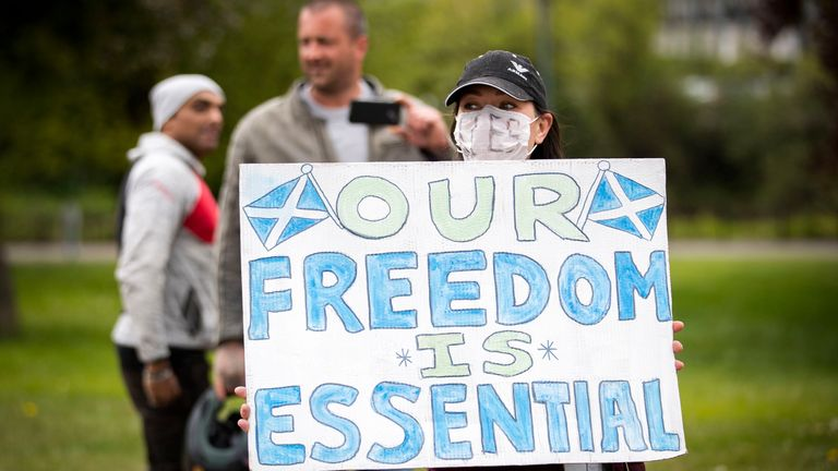 Members of the public gather in Glasgow Green to protest against the coronavirus lockdown restrictions