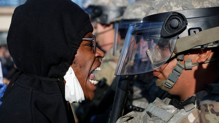 A protester yells at a member of the Minnesota National Guard Friday, May 29, 2020, in Minneapolis