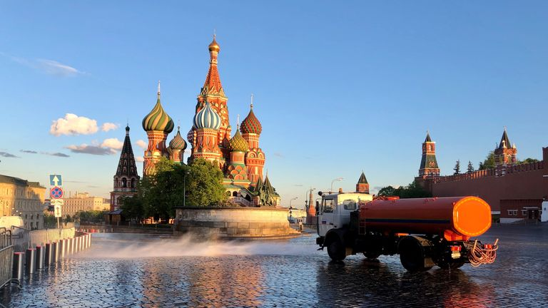 A lorry is seen spraying disinfectant in Moscow's famous Red Square. Pic: Anastasia Leonova