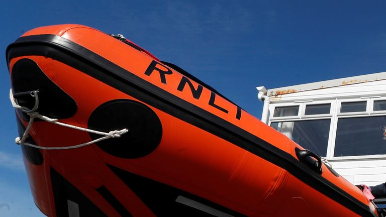 An RNLI lifeguard is seen cleaning a lifeboat, following the outbreak of the coronavirus disease (COVID-19), Margate, Britain, May 22, 2020. REUTERS/Paul Childs