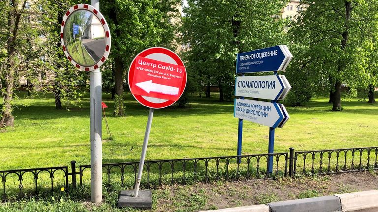 A road sign reads: 'Covid-19 centre. Federal hospital by A. N. Bakuleva. Russian health ministry'.