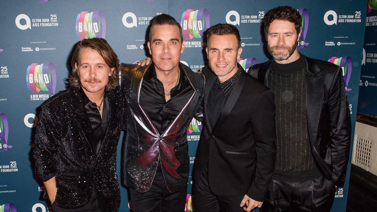 Robbie Williams and Take That will reunite for the online gig on Friday. File pic