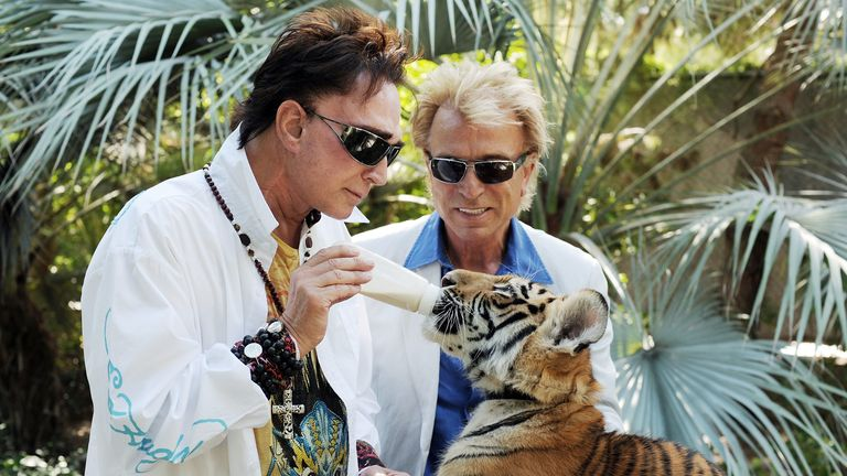 Roy Horn feeds a four-month-old tiger cub at Siegfried and Roy's Secret Garden at the Mirage Hotel and Casino in Las Vegas in 2008