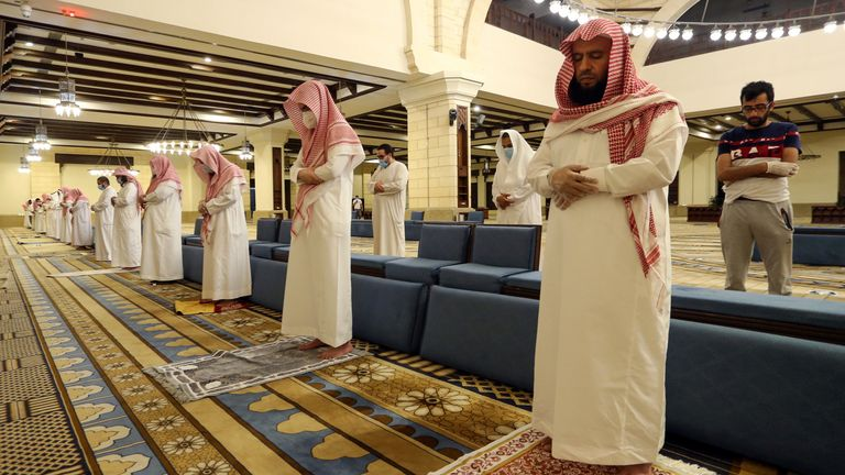 Muslims perform the Al-Fajr prayer inside the Al-Rajhi Mosque while practicing social distancing, after the announcement of the easing of lockdown measures amid the coronavirus disease (COVID-19) outbreak, in Riyadh