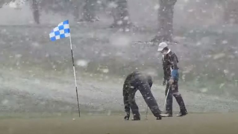 Golfers refuse to stop playing through the heavy snowfall in New York