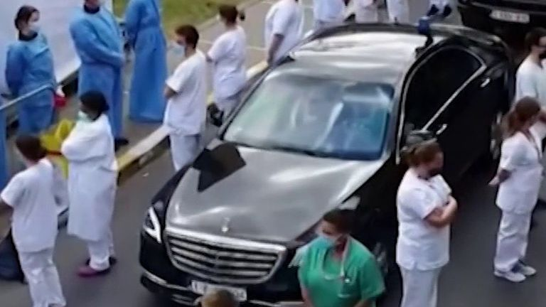 Doctors and nurses turn their backs on Belgium's prime minister at hospital